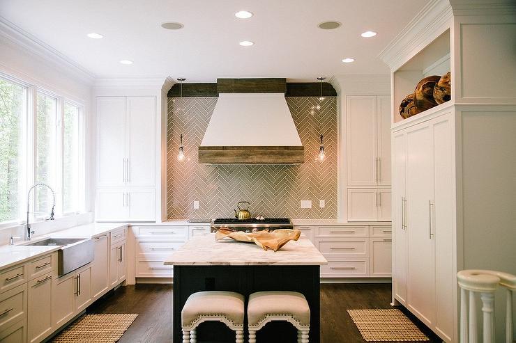 white galley style kitchen with herringbone backsplash glass marble tile backsplash glass marble tile backsplash