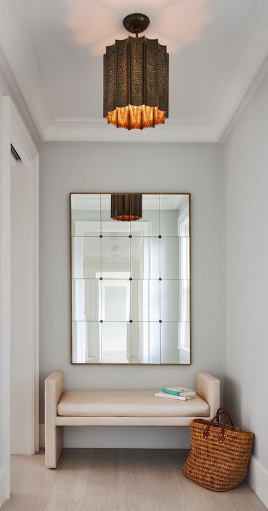 Foyer Panel Design : Foyer with copper light pendant cream bench