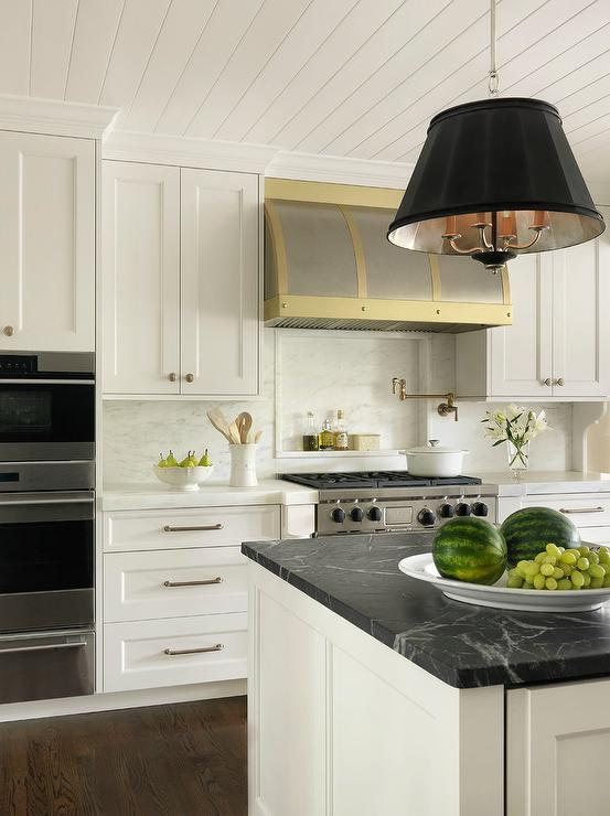 Merveilleux White And Gold Kitchen With Honed Black Marble Countertops