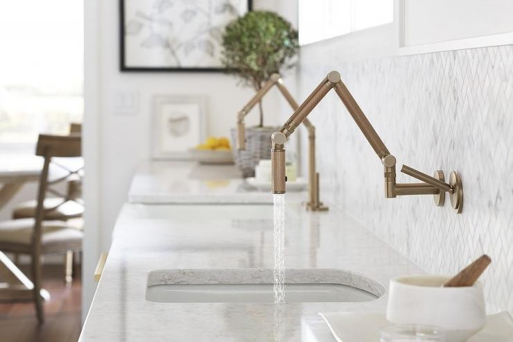 beautiful kitchen features a prep sink with a brass kohler karbon faucet mounted to marble herringbone backsplash beside a matching faucet fixed to a white. Interior Design Ideas. Home Design Ideas