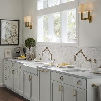 Light Gray Kitchen Cabinets With Wall Mount Brass Pivot Faucets