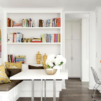 built in bookcase over l shaped dining banquette