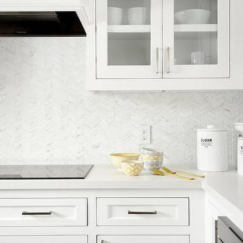 white kitchen with white mini herringbone tiles