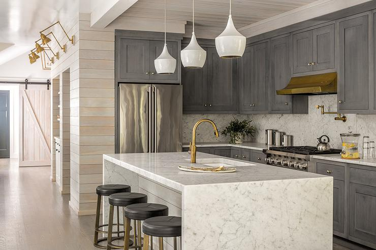 Marble Waterfall Island Countertop With Black Leather Swivel Stools
