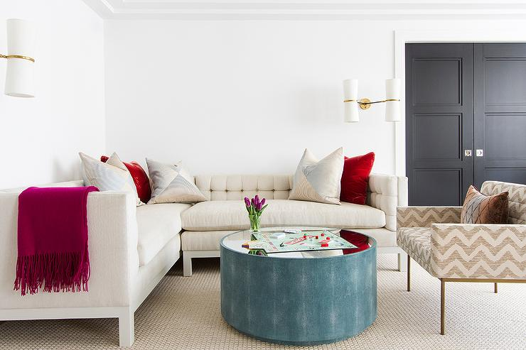 Ivory Tufted Sectional with Round Blue Shagreen Coffee Table ...