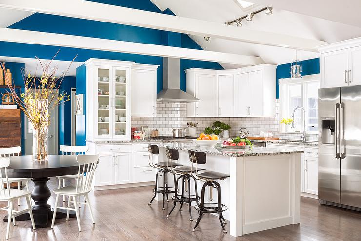 White And Blue Kitchen With Wood Beams On Vaulted Ceiling