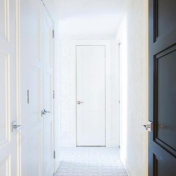 Long Hallway With Blue Geometric Carpeting