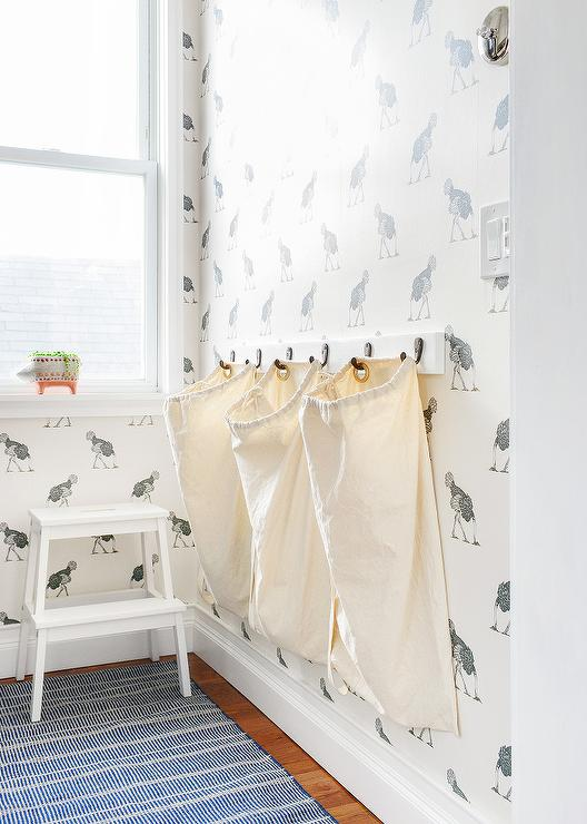 Laundry Room Hampers Hanging From Wall Hooks