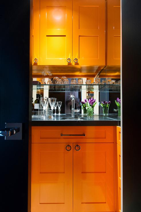 Orange Wet Bar Cabinets With Black Countertops