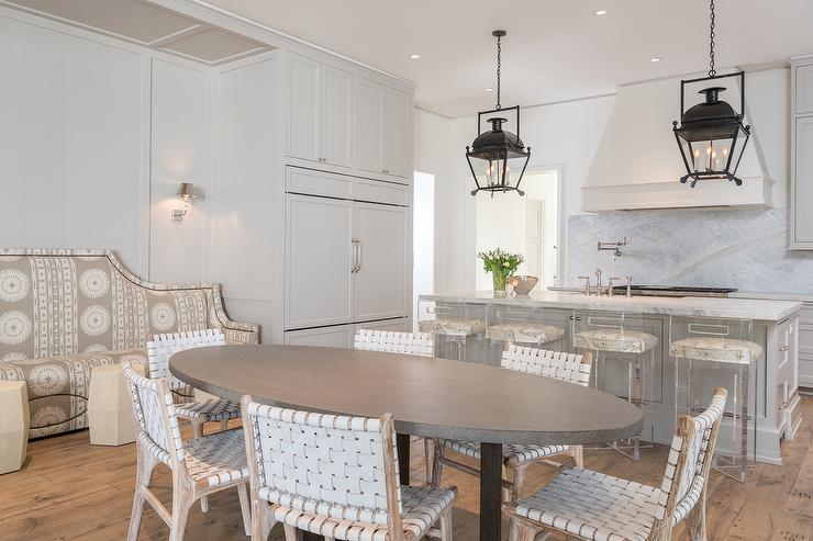 view full size gorgeous eatin kitchen boasts an oval gray dining table surrounded by white leather weave dining chairs and