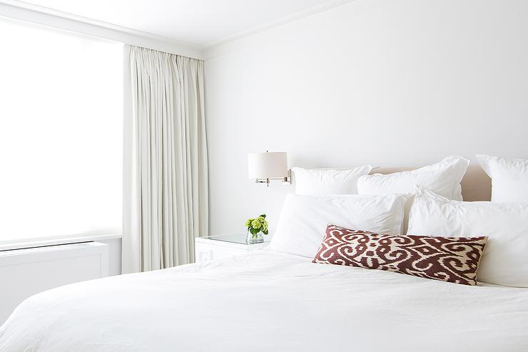 All White Bedroom with Tan Headboard and Brown Ikat Pillows ...