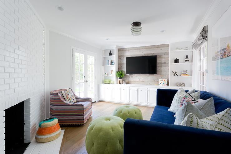 White Brick Fireplace With Royal Blue Velvet Sofa