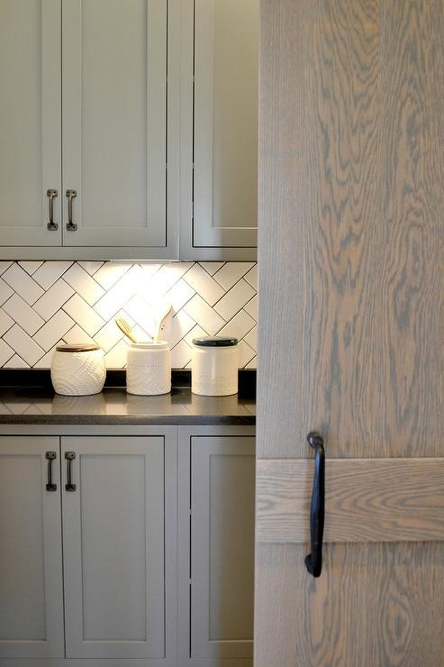 White Herringbone Backsplash Tiles with Black Grout Transitional