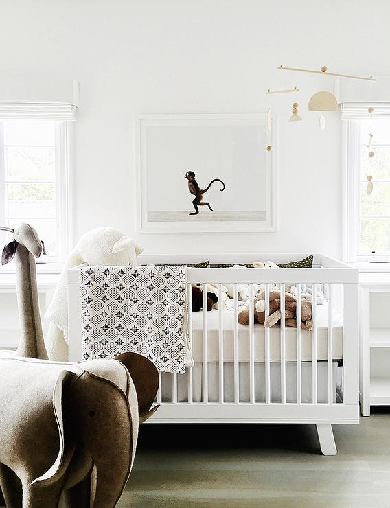 erin fetherston stunning nursery features a rh baby u0026 child oversized wool felt giraffe and elephant placed in front of a babyletto hudson crib positioned
