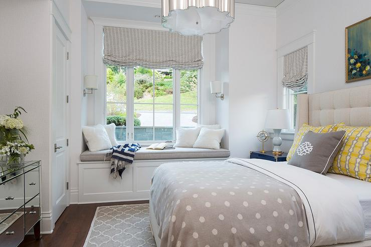 bedroom built in window seat nook with wainscoting transitional