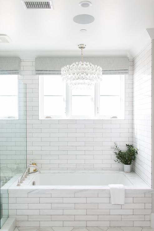 Oval Crystal Chandelier Over Marble Tiled Bathtub