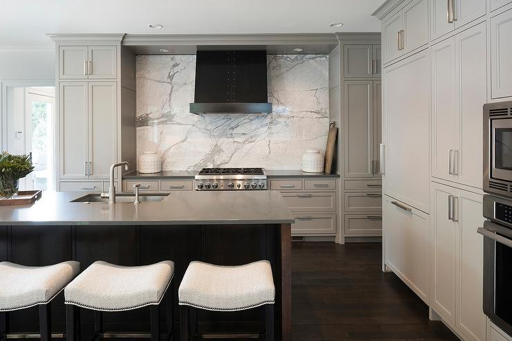 Light Gray Kitchen Cabinets With Charcoal Gray Quartz Countertops - Light gray stained cabinets