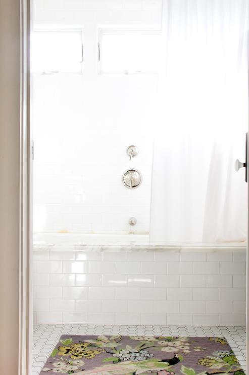 White Subway Tiled Bathtub With Marble Tub Deck