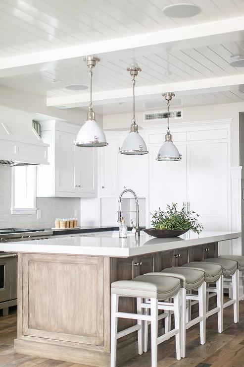 Gray Wash Center Island With Light Gray Backless Barstools