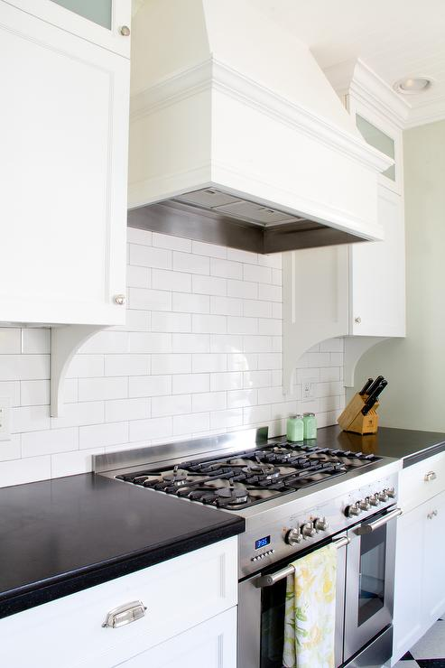 White Wood Kitchen Hood With All White Subway Tiles
