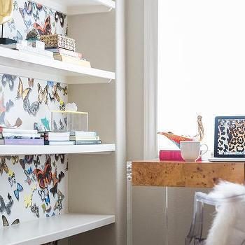 multi color butterfly wallpaper on back of shelves
