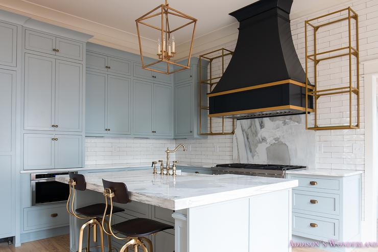 Gray kitchen cabinets with gold and black kitchen hood Sherwin williams uncertain gray