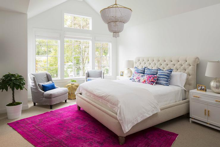 Cream Tufted Sleigh Headboard With Hot Pink Overdyed Rug Transitional Bedroom