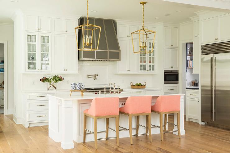 White Kitchen Island With Pink Counter Stools Transitional Kitchen - Lanterns over kitchen island