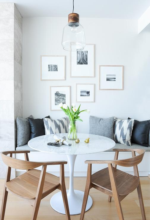 Black And White Photo Gallery Over Dining Bench