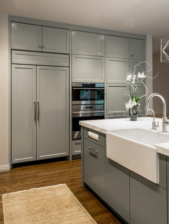Floor to Ceiling Gray Kitchen Cabinets Concealing Refrigerator