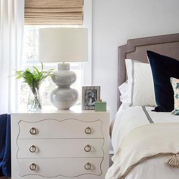 white dresser nightstand with blue banded curtains