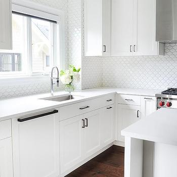 White Kitchen Cabinets With All White Backsplash Tiles