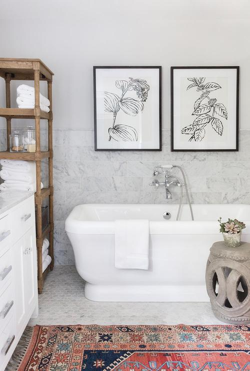 Two Art Pieces Over Bathtub Transitional Bathroom