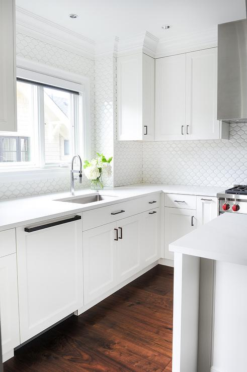 White Kitchen Cabinets with All White Backsplash Tiles ...