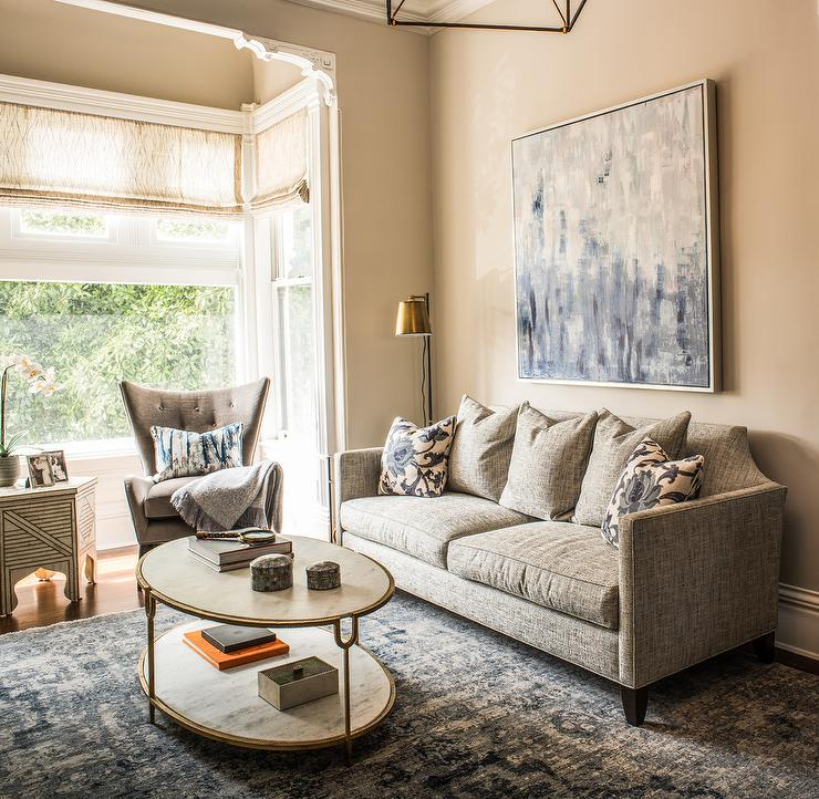 Blue And Gray Contemporary Living Room Features A Abstract Art Over Taupe Linen Sofa Adorned With Floral Pillows Facing Global Views Iron