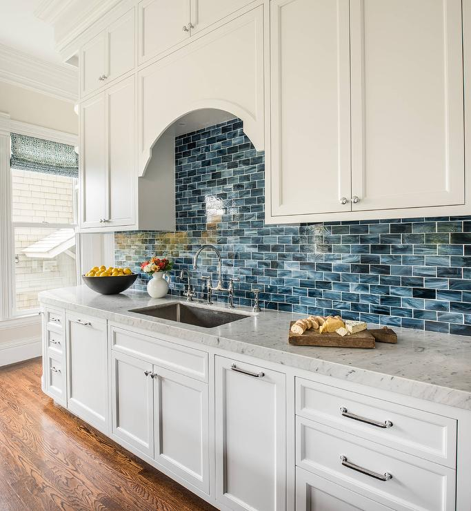 White Kitchen Cabinets With Blue Mini Brick Backsplash Tiles Transitional Kitchen