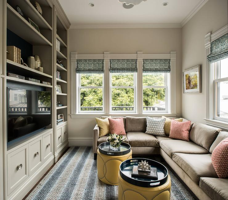 Light Brown Sectional With Gray And Blue Striped Rug