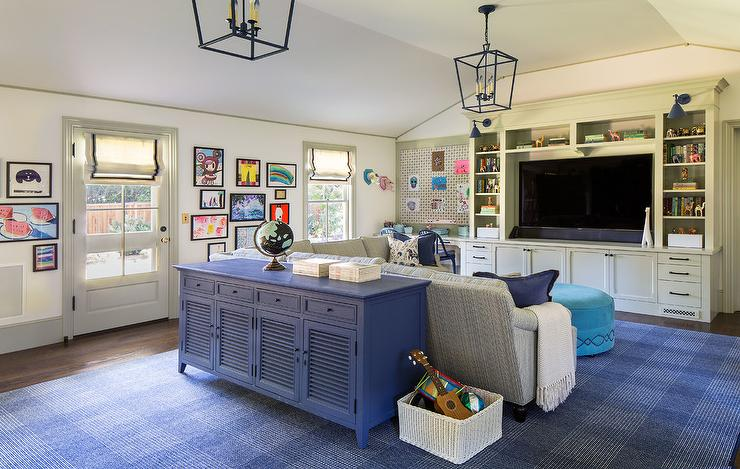 Family Room And Playroom With Kids Art On Wall