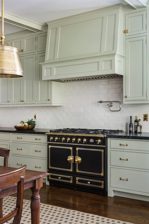 Light Green Gray Cabinets With Black French Stove Transitional - Pale green kitchen cabinets