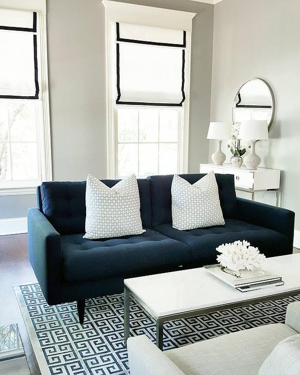 Captivating Navy Blue Tufted Sofa With Blue Greek Key Rug
