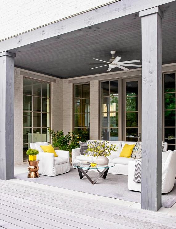 White Outdoor Sofa With Yellow Outdoor Pillows