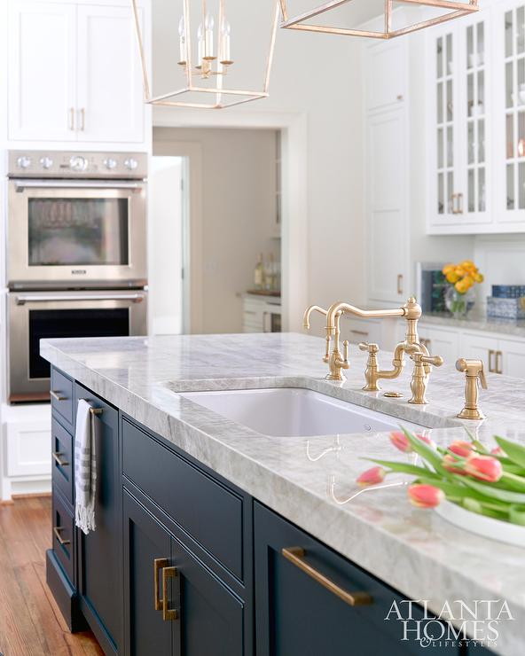 Dark blue center island with brass pulls transitional for Blue and white kitchen cabinets
