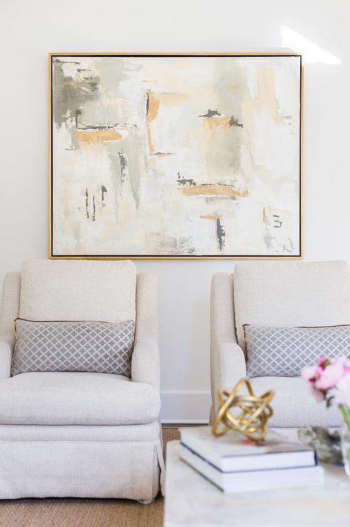 Alyssa Rosenheck: Gold Abstract Art Over Light Gray Accent Chairs