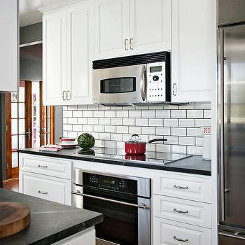 Kitchen With White Subway Tiles With Black Grout