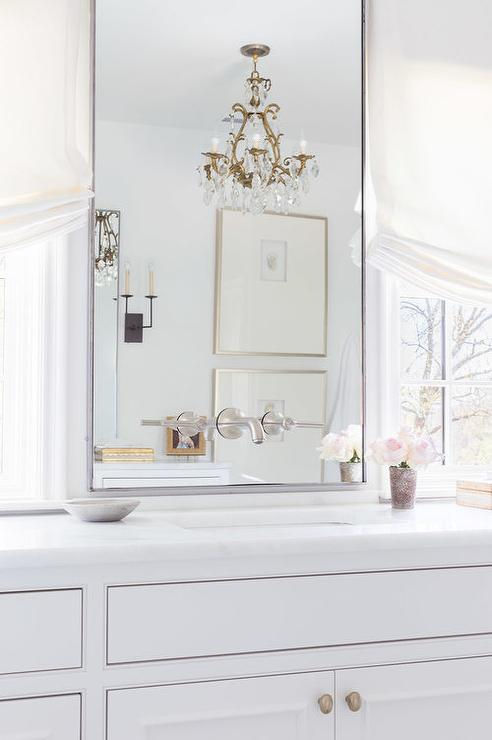 alyssa rosenheck bath vanity mirror between windows