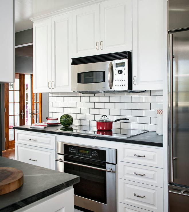 Black And White Kitchen Tiles: Stainless Steel Kitchen Cabinets With Black Subway Tile Backsplash