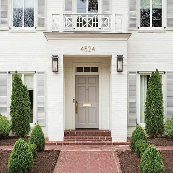 White Brick Painted Home With Gray Front Door