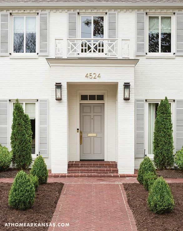 White Brick Painted Home With Gray Front Door Transitional Home