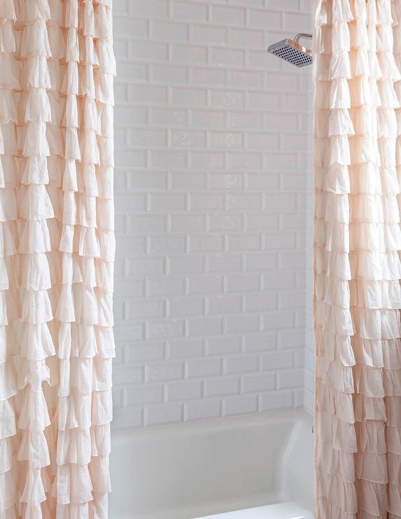 Drop In Bathtub With Two Pink Ruffled Shower Curtains
