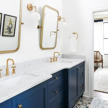 Gray sink vanity with white and black cement floor tiles for Navy blue and gold bathroom accessories